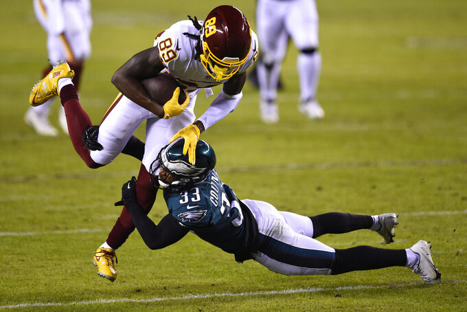 Washington Football Team's Cam Sims (89) is tackled by Philadelphia Eagles' Blake Countess (33) during the first half of an NFL football game, Sunday, Jan. 3, 2021, in Philadelphia. (AP Photo/Derik Hamilton)