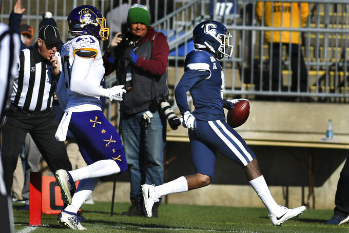 Connecticut wide receiver Cameron Ross (9) runs in for a touchdown during the first half of an NCAA college football game against East Carolina Saturday, Nov. 23, 2019, in East Hartford, Conn. (AP Photo/Stephen Dunn)