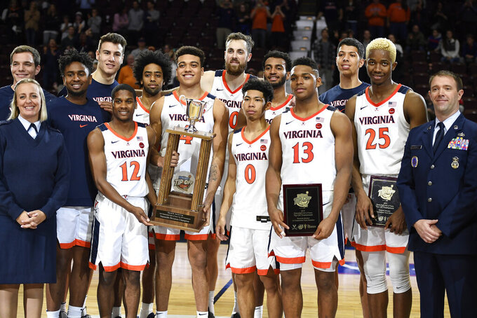 Virginia poses with the 2019 Basketball Hall of Fame Tip Off Tournament championship trophy after their win over Arizona State in an NCAA college basketball game, Sunday, Nov. 24, 2019, in Uncasville, Conn. (AP Photo/Jessica Hill)