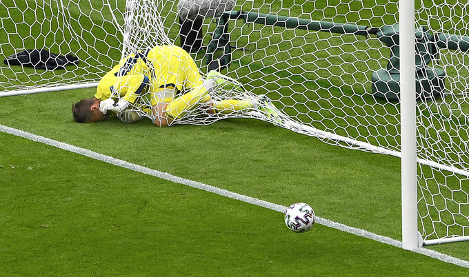 Scotland's goalkeeper David Marshall is caught in the goal's net after he failed to save a long distance shot by Czech Republic's Patrik Schick during the Euro 2020 soccer championship group D match between Scotland and Czech Republic at Hampden Park stadium in Glasgow, Monday, June 14, 2021. (AP Photo/Andy Buchanan, Pool)