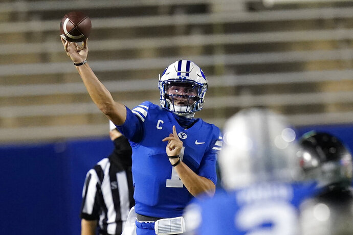 BYU quarterback Zach Wilson throws a pass during the first half against Troy in an NCAA college football game Saturday, Sept. 26, 2020, in Provo, Utah. (AP Photo/Rick Bowmer, Pool)