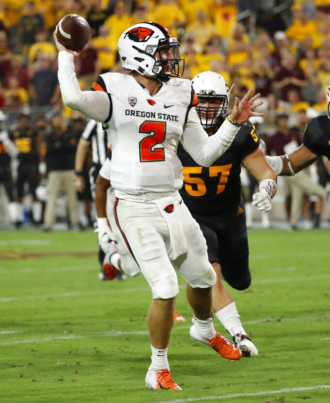 Oregon State quarterback Conor Blount (2) throws as Arizona State defensive lineman Jordan Hoyt (57) pursues during the second half of an NCAA college football game, Saturday, Sept. 29, 2018, in Tempe, Ariz. (AP Photo/Matt York)