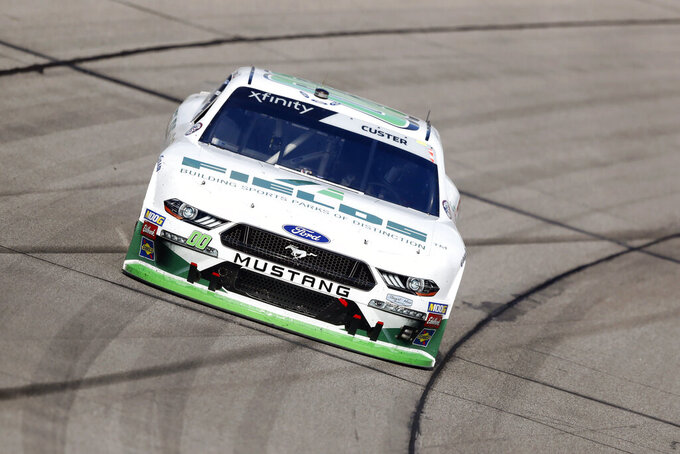Cole Custer races his car during a NASCAR Xfinity Series auto race, Sunday, June 16, 2019, at Iowa Speedway in Newton, Iowa. (AP Photo/Charlie Neibergall)