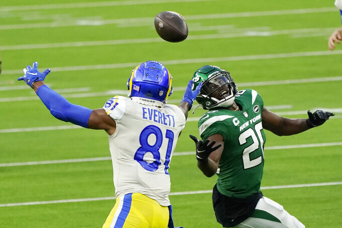 Los Angeles Rams tight end Gerald Everett (81) catches a tipped pass in front of New York Jets free safety Marcus Maye during the second half of an NFL football game Sunday, Dec. 20, 2020, in Inglewood, Calif. (AP Photo/Ashley Landis)