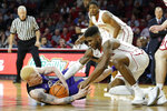 TCU's Jaylen Fisher (0) fights for the ball with Oklahoma's Rashard Odomes (1) during the first half of an NCAA college basketball game in Norman, Okla., Saturday, Jan. 13, 2018. (AP Photo/Garett Fisbeck)