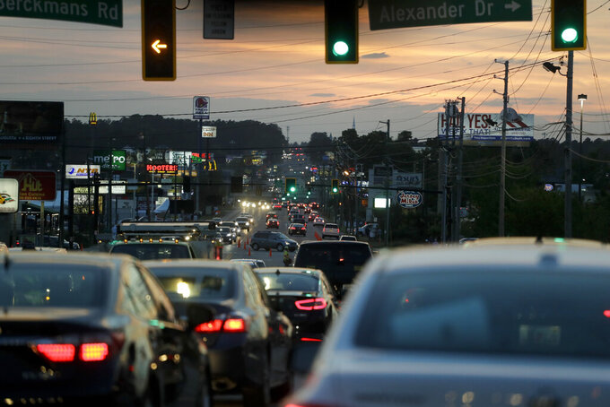 FILE - In this April 12, 2019, file photo, traffic is shown along Washington Road after the second round for the Masters golf tournament in Augusta, Ga. Augusta was supposed to host the golf's first major championship this week. But the Masters has been put off until at least November, dealing the Georgia city a huge financial blow. (AP Photo/Chris Carlson, File)