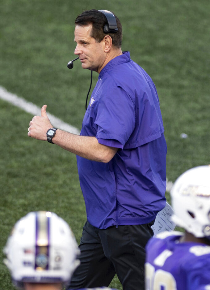 James Madison head coach Curt Cignetti gives a thumbs-up during the first half of a quarterfinal game against North Dakota in the NCAA FCS football playoffs in Harrisonburg, Va., Sunday, May 2, 2021. (Daniel Lin/Daily News-Record via AP)