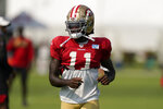 San Francisco 49ers' Brandon Aiyuk walks on the field during NFL football practice in Santa Clara, Calif., Tuesday, Aug. 18, 2020. (AP Photo/Jeff Chiu, Pool)