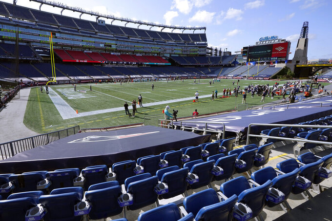 The New England Patriots and Miami Dolphins play in an empty Gillette Stadium due to the coronavirus pandemic in the second half of an NFL football game, Sunday, Sept. 13, 2020, in Foxborough, Mass. (AP Photo/Steven Senne)