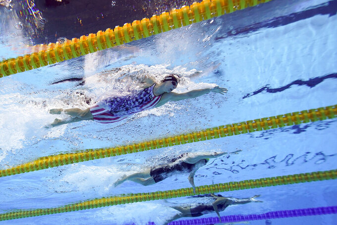 United State's Katy Ledecky, top, swims in a 200-meter freestyle semifinal at the 2020 Summer Olympics, Tuesday, July 27, 2021, in Tokyo. (AP Photo/David J. Phillip)