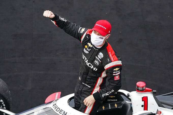 Josef Newgarden celebrates after winning an IndyCar auto race at Indianapolis Motor Speedway in Indianapolis, Friday, Oct. 2, 2020. (AP Photo/Michael Conroy)