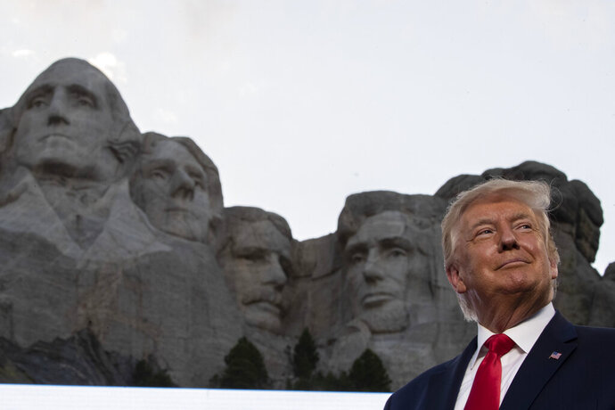 FILE - In this July 3, 2020, file photo, President Donald Trump stands at Mount Rushmore National Memorial, near Keystone, S.D. South Dakota Gov. Kristi Noem says she gave former president Donald Trump a $1,100 bust depicting the president on Mount Rushmore last year because she knew it was something he wanted to receive. The gift was presented to Trump when he visited South Dakota on Friday, July 3, 2020 for an Independence Day fireworks celebration. (AP Photo/Alex Brandon, File)