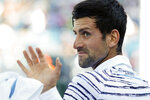 Novak Djokovic waves down the line between games in the first set against Sam Querrey at the Western & Southern Open tennis tournament in Mason, Ohio, Tuesday, Aug. 13, 2019. (Sam Greene/The Cincinnati Enquirer via AP)