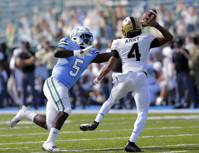 Tulane defensive end Cameron Sample (5) applies pressure to Army quarterback Christian Anderson (4) during an NCAA college football game in New Orleans, La., Saturday, Nov. 14, 2020. (A. J. Sisco/The Advocate via AP)
