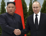 Russian President Vladimir Putin, right, and North Korea's leader Kim Jong Un posing for a photo prior to their talks in Vladivostok, Russia, Thursday, April 25, 2019. Russian President Vladimir Putin and North Korean leader Kim Jong Un say they have had fruitful talks about how to defuse a standoff over Pyongyang's nuclear program. (Alexei Nikolsky, Sputnik, Kremlin Pool Photo via AP)