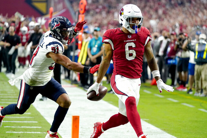 Arizona Cardinals running back James Conner (6) scores a touchdown as Houston Texans outside linebacker Kamu Grugier-Hill (51) defends during the second half of an NFL football game, Sunday, Oct. 24, 2021, in Glendale, Ariz. (AP Photo/Ross D. Franklin)