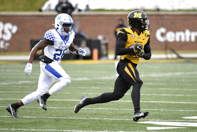 Missouri wide receiver Jalen Knox, right, catches a pass as Kentucky defensive back Brandin Echols defends during the second half of an NCAA college football game Saturday, Oct. 24, 2020, in Columbia, Mo. (AP Photo/L.G. Patterson)