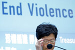 Hong Kong Chief Executive Carrie Lam speaks during a press conference held in Hong Kong on Friday, Oct. 4, 2019. Lam announced that protesters are banned from wearing masks to conceal their identities in a hardening of the government's stance against the 4-month-old demonstrations. (AP Photo/Kin Cheung)