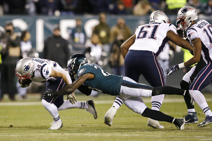 New England Patriots' Rex Burkhead (34) is tackled by Philadelphia Eagles' Malcolm Jenkins (27) during the first half of an NFL football game, Sunday, Nov. 17, 2019, in Philadelphia. (AP Photo/Michael Perez)