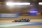 Mercedes driver Lewis Hamilton of Britain steers his car during the second free practice at the Formula One Bahrain International Circuit in Sakhir, Bahrain, Friday, Nov. 27, 2020. (Hamad Mohammed, Pool via AP)