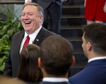 Secretary of State Mike Pompeo smiles while meeting employees after announcing a new 'ethos' statement in the lobby staircase of the U.S. State Department headquarters in Washington, Friday, April 25, 2019. (AP Photo/Pablo Martinez Monsivais)