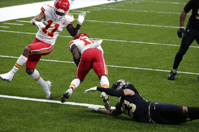 New Orleans Saints quarterback Jameis Winston (2)3 can't defend as Kansas City Chiefs wide receiver Tyreek Hill (10) pulls in a touchdown reception in the first half of an NFL football game in New Orleans, Sunday, Dec. 20, 2020. (AP Photo/Butch Dill)