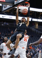 Colorado's Tyler Bey (1) dunks against Clemson during the second half of an NCAA college basketball game, Tuesday, Nov. 26, 2019, in Las Vegas. (AP Photo/John Locher)