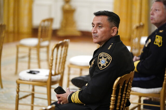 Bernalillo County Sheriff Manuel Gonzales, left, and Kansas City police Chief Rick Smith, wait for an event on