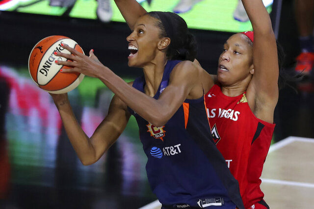 Connecticut Sun's DeWanna Bonner, left, drives past Las Vegas Aces' A'ja Wilson during the first half of a WNBA basketball game Thursday, Sept. 3, 2020, in Bradenton, Fla. (AP Photo/Mike Carlson)