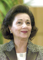 FILE - In this Feb. 19, 2003 file photo, Suzanne Mubarak, wife of Egypt's President Hosni Mubarak, smiles at the Free University Berlin. One of the sons of Egypt's former autocratic President Hosni Mubarak says his 78-year-old mother and former first lady is in hospital. Alaa Mubarak tweeted late Wednesday, Nov. 20, 2019, that Suzanne Mubarak was in intensive care but didn't elaborate on her illness. (AP Photo/Franka Bruns, File)