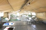 In this photo provided by the International Committee for the Red Cross the interior of a new field hospital for coronavirus patients in the Yemen's main southern city of Aden. The Red Cross announced the opening of the facility on Monday, Sept. 21, 2020 as the virus continues to spread largely unchecked in the war-torn country. Many medical facilities in the country have closed as staffers flee or turn patients away. (International Committee for the Red Cross via AP)