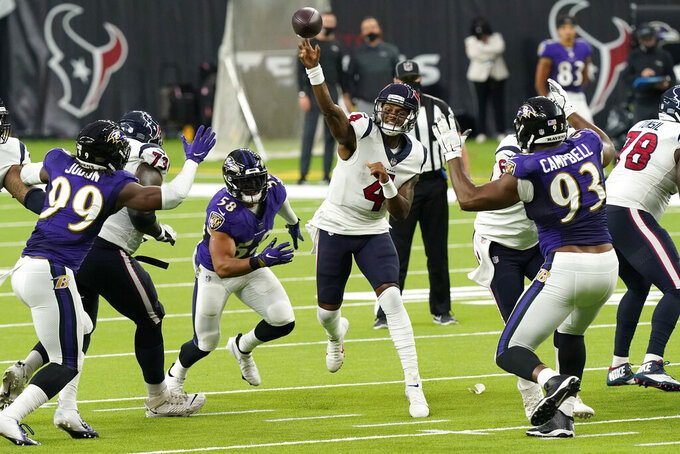 Houston Texans quarterback Deshaun Watson (4) throws against the Baltimore Ravens during the second half of an NFL football game Sunday, Sept. 20, 2020, in Houston. (AP Photo/David J. Phillip)