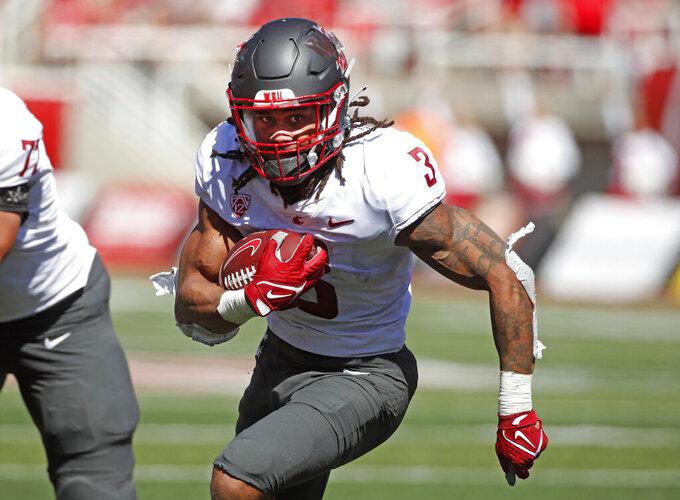 Washington State running back Deon McIntosh (3) runs the ball in the first half, of an NCAA college football game against Utah Saturday, Sept. 25, 2021, in Salt Lake City, Utah. (AP Photo/George Frey)