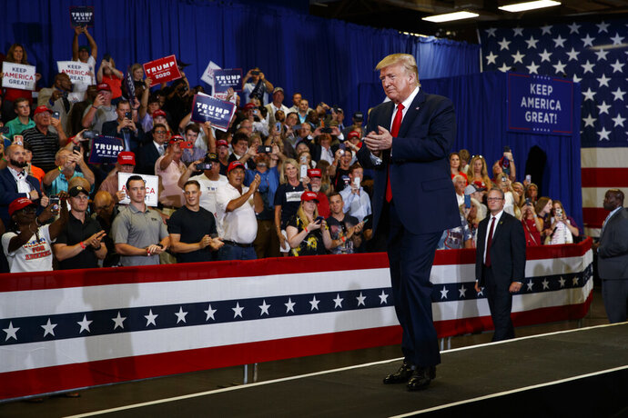 President Donald Trump arrives on stage at the Crown Expo for a campaign rally, Monday, Sept. 9, 2019, in Fayetteville, N.C. (AP Photo/Evan Vucci)