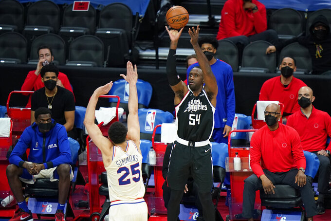 Los Angeles Clippers' Patrick Patterson (54) goes up for a shot against Philadelphia 76ers' Ben Simmons (25) during the second half of an NBA basketball game, Friday, April 16, 2021, in Philadelphia. (AP Photo/Matt Slocum)