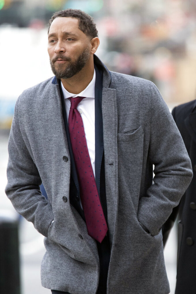 Former Southern California assistant basketball coach Tony Bland arrives at federal court in New York, Wednesday, Jan. 2, 2019. Bland is expected to plead guilty in a criminal case in which prosecutors said bribes were paid to steer top athletes to certain schools. (AP Photo/Mary Altaffer)