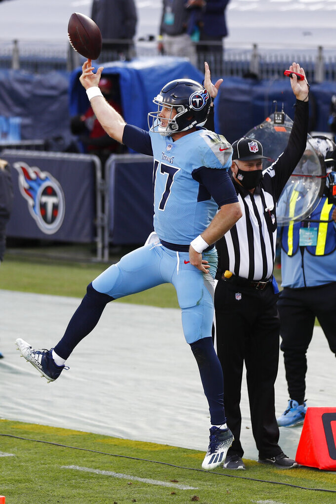 Tennessee Titans quarterback Ryan Tannehill celebrates after scoring a 2-point conversion against the Cleveland Browns in the second half of an NFL football game Sunday, Dec. 6, 2020, in Nashville, Tenn. (AP Photo/Wade Payne)