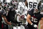 Las Vegas Raiders running back Josh Jacobs (28) runs against Atlanta Falcons during the second half of an NFL football game, Sunday, Nov. 29, 2020, in Atlanta. (AP Photo/Brynn Anderson)