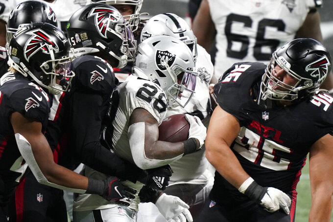 Las Vegas Raiders running back Josh Jacobs (28) runs against Atlanta Falcons during the second half of an NFL football game, Sunday, Nov. 29, 2020, in Atlanta. (AP Photo/Brynn Anderson)
