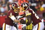 Washington Redskins quarterback Case Keenum (8) hands the ball off to running back Adrian Peterson (26) during the first quarter of the team's NFL preseason football game against the Cincinnati Bengals in Landover, Md., Thursday, Aug. 15, 2019. (AP Photo/Susan Walsh)
