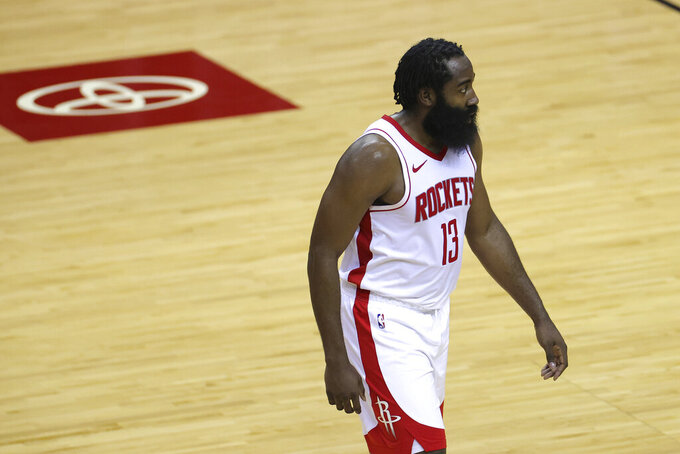 Houston Rockets' James Harden looks on during the second half of an NBA basketball game against tha San Antonio Spurs in Houston, Thursday, Dec. 17, 2020. (Carmen Mandato/Pool Photo via AP)