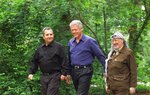 FILE - President Bill Clinton, center, Israeli Prime Minister Ehud Barak, left, and Palestinian leader Yasser Arafat walk on the grounds of Camp David, Md., at the start of the Mideast summit on July 11, 2000. A new documentary