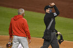 Home plate umpire Junior Valentine, right, ejects Philadelphia Phillies manager Joe Girardi, left, during the third inning of a baseball game against the Washington Nationals, Monday, Sept. 21, 2020, in Washington. (AP Photo/Nick Wass)
