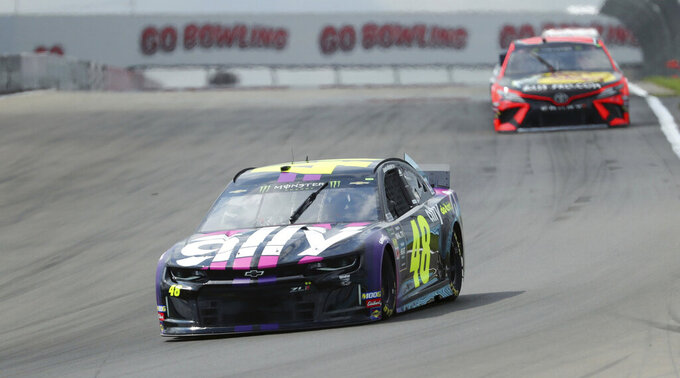 Jimmie Johnson (48) heads into turn one during a practice run for the NASCAR Cup Series auto race at Watkins Glen International, Saturday, Aug. 3, 2019, in Watkins Glen, New York. (AP Photo/John Munson)