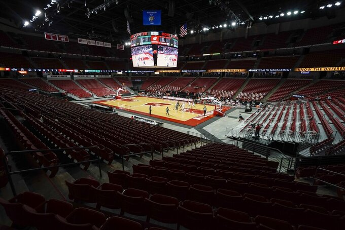 The seats at the Kohl Center are empty during the first half of an NCAA college basketball game between Wisconsin and Wisconsin-Green Bay Tuesday, Dec. 1, 2020, in Madison, Wis. (AP Photo/Morry Gash)