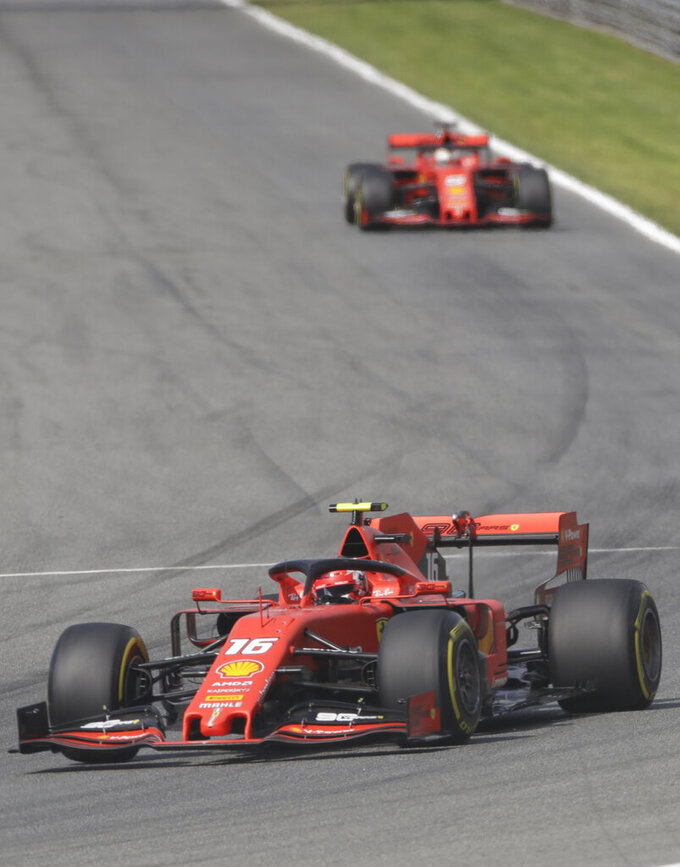 Ferrari driver Charles Leclerc of Monaco leads Ferrari driver Sebastian Vettel of Germany during the qualifying session at the Monza racetrack, in Monza, Italy, Saturday, Sept. 7, 2019. The Formula one race will be held on Sunday. (AP Photo/Luca Bruno)