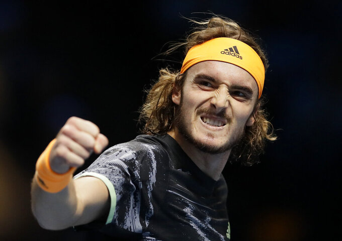 FILE - In this Nov. 11, 2019, file photo, Stefanos Tsitsipas of Greece celebrates winning a point against Daniil Medvedev of Russia during their ATP World Tour Finals singles tennis match at the O2 Arena in London. Tsitsipas is scheduled to play in the U.S. Open, scheduled for Aug. 31-Sept. 13, 2020.(AP Photo/Kirsty Wigglesworth, File)