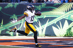 Pittsburgh Steelers wide receiver James Washington runs in a touchdown during the second half an NFL football game against the Cincinnati Bengals, Sunday, Nov. 24, 2019, in Cincinnati. (AP Photo/Frank Victores)