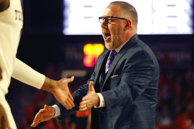 Texas A&M coach Buzz Williams celebrates with his team during an NCAA basketball game against Georgia in Athens, Ga., on Saturday, Feb. 1, 2020. (Joshua L. Jones/Athens Banner-Herald via AP)