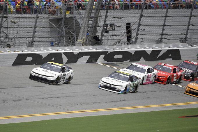 AJ Allmendinger (16) and Justin Haley (11) lead a group of drivers along the front stretch during a NASCAR Xfinity Series auto race at Daytona International Speedway, Saturday, Aug. 28, 2021, in Daytona Beach, Fla. (AP Photo/Phelan M. Ebenhack)